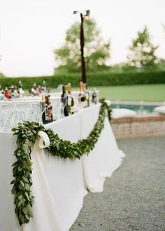 gorgeous garland draping a simple bar