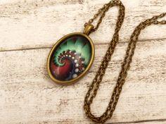 Halskette mit abstraktem Spiral Motiv in türkis von Schmucktruhe