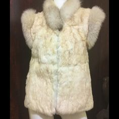 vest real rabbit with fox trim SALE only today❤️❤️ Beautiful rabbit and fox fur size small. Closes with 3 hooks. Colors on the vest are light blond and off white with fox fur trim off white with a darker color at tips,please see pictures. No rips,tears,holes. No shedding. Has two pockets. The only issue are inside the lining are some stains and snags I have shown in last picture nothing major. Please see all pictures and measurements. No trades or low balls. Length is 25 inch,bust is 17in…