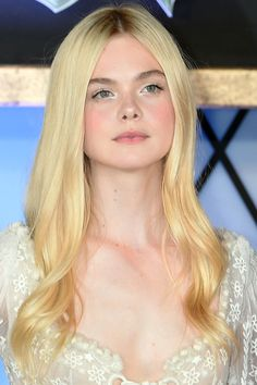 June 24, 2014-Etheral eyes (ivory shimmery eyes on lids and silver on the inner corner) as seen on Elle Fanning. Watch out Dakota. Gorgeous....