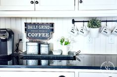 BRIGHTEN UP YOUR KITCHEN WITH WHITE . Love the white bead board backsplash and the white cups hanging from the black rod.