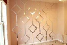 RIDICULOUSLY GENIUS — apply foil tape to a wall in a pretty design. $7.50 for the whole thing.