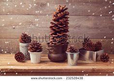Pine corn decoration for Christmas table setting - stock photo