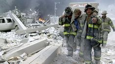 pictures of 911 | 11 picture: firefighters helping an injured colleague