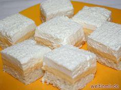 Leckeres Rezept für Kuchen mit Kokosteig, Puddingcreme und Sahne.