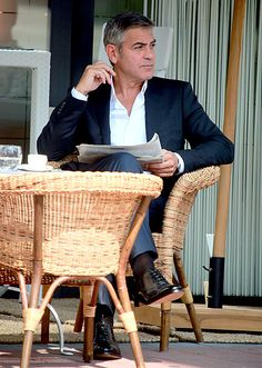 Clooney Chillaxes: George Clooney struck a nonchalant pose shooting a Mercedes ad in Milan, Italy August 1.