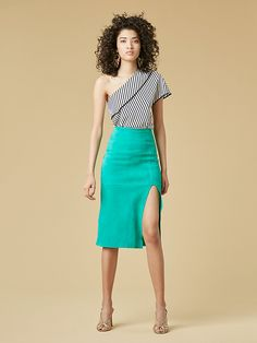 Suede Pencil Skirt. With a daring side slit and in a bright jade hue, this sleek pencil skirt is cut from luxurious suede. With a soft suede face and smooth nappa back, it is sophisticated inside and out.