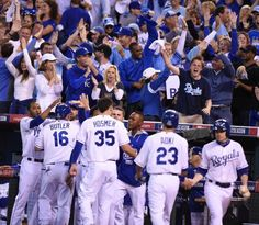 Kansas City Royals players react after Alex Gordon hit a double to score three runs in the first inning against Los Angeles Angels at Sunday's ALDS playoff baseball game on October 5, 2014 at Kauffman Stadium in Kansas City, MO.