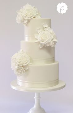 White on white modern sugar rose wedding cake
