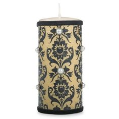 Cut printed tissue to height of candle. Wrap around the candle and leave enough to overlap and secure with adhesive tape.  Add velvet ribbon around top and bottom of tissue.  Embellish with pearl pins.  ~www.michaels.com