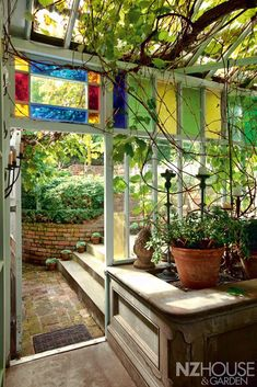 Very cool Garden Room leading outside . with Stained Glass windows . What Is A Conservatory, Conservatory Design, Window Greenhouse, Greenhouse Ideas, Small Greenhouse, Love Garden, Home And Garden, Glass House Garden, Earthship Plans