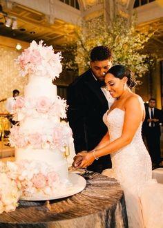 NFL player Devon Still cutting the beautiful wedding cake with his new wife Asha Joyce.