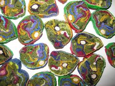 to create my fabric millefiori jewelry, I use 97% recycled  fabrics & fibers . After fully saturating the textiles with liquid glue I roll them up. The glue hardens and protects them and when dry, I slice the roll cross-section. These very durable, vivid and intricately detailed slices become earrings, pins and pendants, which are truly FABRIC JEWELS!  Because the sliced fabric is almost weightless, wearing this artwork is a pleasure!