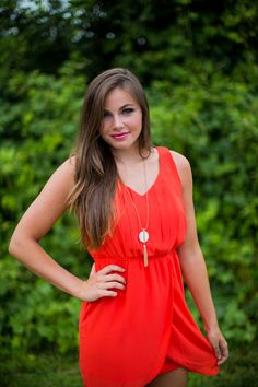 We just LOVE the cut of this dress! Now available at Entourage!
