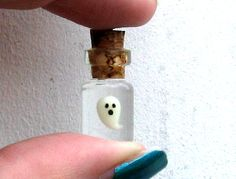 A cute and tiny 5 mm tall glow-in-the-dark polymer clay ghost suspended in a tiny corked bottle. The bottle is 18 mm without the cork. A great gift for your ghost-loving loved ones or the perfect little something to wear for Halloween. This can be made into a cell phone charm with a black strap, a pendant on a black cotton cord necklace, or it can be left as a simple charm. All of this is free of charge! Or, for $2 or $3 more, you can have it on either a bronze or sterling silver chain…