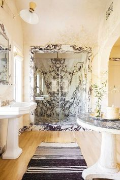 In the bathroom of Nate Berkus and Jeremiah Brent, a luxurious veiny marble draws the eye on the shower, while continuing throughout the room in baseboards, backsplashes, and door frames. Do like Berkus and Brent and use marble in unexpected ways to create a unique space. Choosing a bold colorful marble is also a great way to make your bathroom stand out.