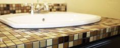 How to build and tile a counter top- seems like a good option for the non-standard-sized vanity top...