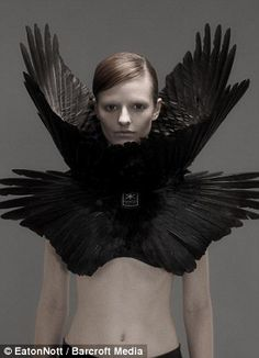 Macabre fashion: A necklace made from a human ribcage, left, deontaed to the artists by a university medical department and a striking bolero made from bird feathers