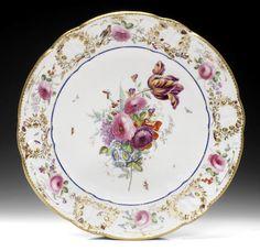 A fine Nantgarw plate, circa 1818-20 Sold for £7,200 (CA$ 11,623)