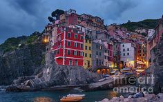 Riomaggiore in Cinque Terre Italy.   Shop for this photo and more at my website at joan-carroll.pixels.com. All works available as a print, canvas, greeting card, pillow cover, tote bag, shower curtain, or phone case.  Thanks!