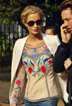 Poppy Delevingne at London Fashion Week in 2012, wearing Sass & Bide jeans, Temperley London top, and Givenchy sandals.