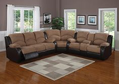 CARRIE The Carrie sectional brings together a large reclining sofa, loveseat, and wedge to create seating spacious enough to accommodate all. Plump, tan padded suede armrests and seating contrast against soft, supple dark brown leatherette in welcoming style. The sectional features a manual reclining sofa and a manual reclining loveseat with a center console that includes cup holders and storage. Also available is a matching gliding action manual recliner chair to complete the look.