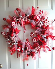 Peppermint Sticks  Lollipops Wreath..way cute! This will match my Chris as decor!