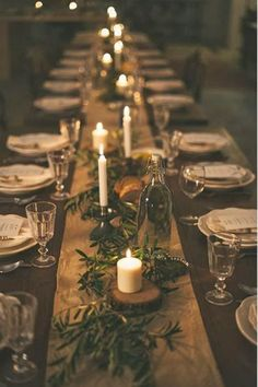 Stick to your roots. Use live Christmas tree branches over your table runner to bring a little bit of the wilderness to your tablescape. Via @magdamontrenko - HarpersBAZAAR.com