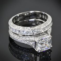 platinum engagement ring is showcasing a 1.94 G VS1 Asscher set with 22 Asscher cut diamonds and 60 A Cut Above Melee diamonds. The matching diamond band is scattered A Cut Above Diamond melee.