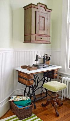 In this laundry-room redo, an antique sewing-machine base topped with marble serves as a sewing table; a modern machine swaps in as needed. | Photo:  Alexandra Rowley