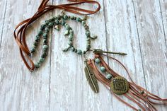 Boho-chic African turquoise and deerskin leather tassel necklace with antique bronze charms and gorgeous cross-shape freshwater pearls.  36 long (adjustable), add 8 for tassel and charms  Ready to ship!  »»»»»»»»»»»»»»»»»»»»»»»»»»»»»»»»»»»»»»»»»»»»»»»»»»  View more of our mother/daughter handmade necklaces here: http://www.BuckskinBetty.Etsy.com  Follow us on Facebook at https://www.facebook.com/BuckskinBettyLLC Follow us on Instagram at https://instagram.com/BuckskinBetty Follow us on…