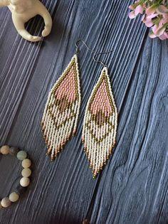 Items similar to Long fringe beaded earrings, geometric ornament earrings, seed bead handwoven earrings, milky pink tones. on Etsy Seed Bead Jewelry, Seed Bead Earrings, Fringe Earrings, Boho Earrings, Beaded Jewelry, Seed Beads, Beaded Earrings Patterns, Beading Patterns, Bracelet Patterns
