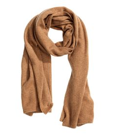 This premium-quality, fine-knit scarf in soft camel cashmere is the perfect neutral to throw on with any cold-weather ensemble. | H&M Accessories