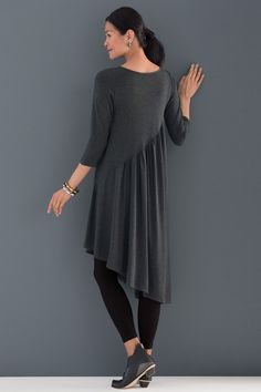 Deanna Dress by Noblu . A sweet dress with verve, in a soft, heathered jersey we love. A pointed asymmetrical hemline draws the eye, while gathers create playful shaping along an angled seam front and back.