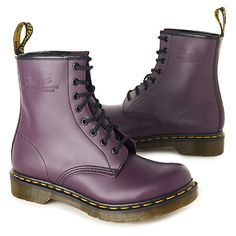"""New color for 2012 Dr. Marten's Classic 8-eye Boots in purple. """"Put a vintage twist on off–duty dressing with DR Martens' Classic 8 boots. Based on the brand's iconic 1460 style, they combine the traditional yellow welt stitching with a soft, lightly grained leather finish. Complete with embossed logo and tread sole."""" i love Dr.Martens, always have since the grunge explosion of my youth...and now it's all coming back-wearing frayed denim shorts with tights underneath and boots and lots of…"""