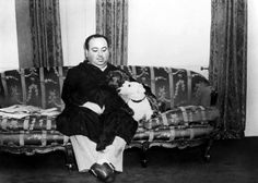A very young Alfred Hitchcock with his furry buddy