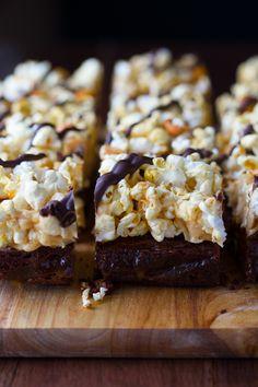 Loaded Popcorn Brownies- loaded with popcorn, caramel, peanuts, marshmallows and chocolate!   sweetpeasandsaffron.com @sweetpeasaffron