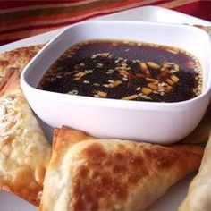 Easy Asian Dipping Sauce           1/2 cup soy sauce     1/2 cup rice wine vinegar     2 tablespoons honey     3 cloves minced garlic     2 tablespoons minced fresh ginger root     2 teaspoons sesame seeds     2 teaspoons sesame oil