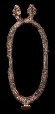 Burkina Faso | Bracelet or anklet from the Gurunsi people | Brass, decorated with plaited band patterns and two human heads with elongated chin and knob-shaped coiffure | Est. 400 - 800 € ~ (June '14)