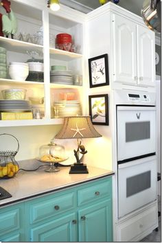 I really like the aqua colored cabinets. Inside of cabinets this aqua shade.