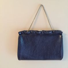Vintage Harry Levine navy blue leather clutch Vintage HL navy blue leather clutch. Adorable! Ruffle detailing around top. Hardware is gold. Leather is dark navy blue could prob pass for black. Gold chain strap can be tucked away inside of clutch or used. Clean / excellent condition! Bags Clutches & Wristlets