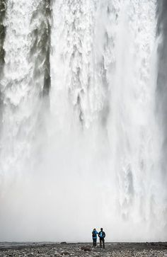 Skogafoss waterfall Iceland Art Print for sale - two people watching impressive Skogafoss falls in South iceland - the pure power of water. Click on the link or the image to buy a poster, fine art print or canvas print: http://matthias-hauser.pixels.com/featured/impressive-waterfall-skogafoss-in-iceland-with-lots-of-water-matthias-hauser.html 30 days money back guarantee. Matthias Hauser hauserfoto.com - Art for your Home Decor and Interior Design needs.