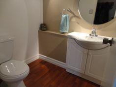 bowed sink and round mirror