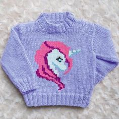This is my standard instarsia children's Sweater with Unicorn head on the front. Unicorn Knitting Pattern, Kids Knitting Patterns, Jumper Patterns, Baby Cardigan Knitting Pattern, Knitting Charts, Knitting For Kids, Baby Girl Sweaters, Unicorn Head, Couture