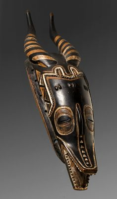 Africa | Mask from the Guro people of Ivory Coast | Wood and pigment || January 2014 Catalogue, pg 19