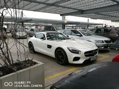 White Mercedes AMG in a parking lot