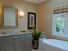"""""""We've been noticing a move away from the need to have multiple sinks in smaller master bathrooms and a focus more on storage,"""" says designer Jason Ball. Using one basin opens up extra counter space and provides extra storage — including pullout drawers on either side of the sink and a tilt-out center drawer to store toiletries."""