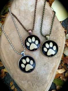 A personal favorite from my Etsy shop https://www.etsy.com/listing/480724089/a-paw-print-on-your-heart-necklace-glow