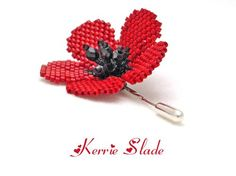 This is an intermediate beadwork project.  This comprehensive 14 page tutorial includes instructions to create the poppy flower shown in the picture.  Instructions for optional leaves are also included.  You should have a working knowledge of brick stitch and ladder stitch.  The finished flower (excluding the leaves) measures approximately 4 cm from side to side.