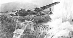 BREACHING THE EDER DAM Graphite Edition - Aces High.by Robert Taylor   Media: Lithograph Robert Taylor pays tribute to the courage and selfless determination 617 Squadron's Dambuster crews, of which eight never returned, with this dramatic pencil rendering.  As his bouncing bomb scores a direct hit, Pilot Officer Les Knight powers his Lancaster over the Eder Dam, a huge deluge of water cascading over the fractured wall as he departs the scene.  16
